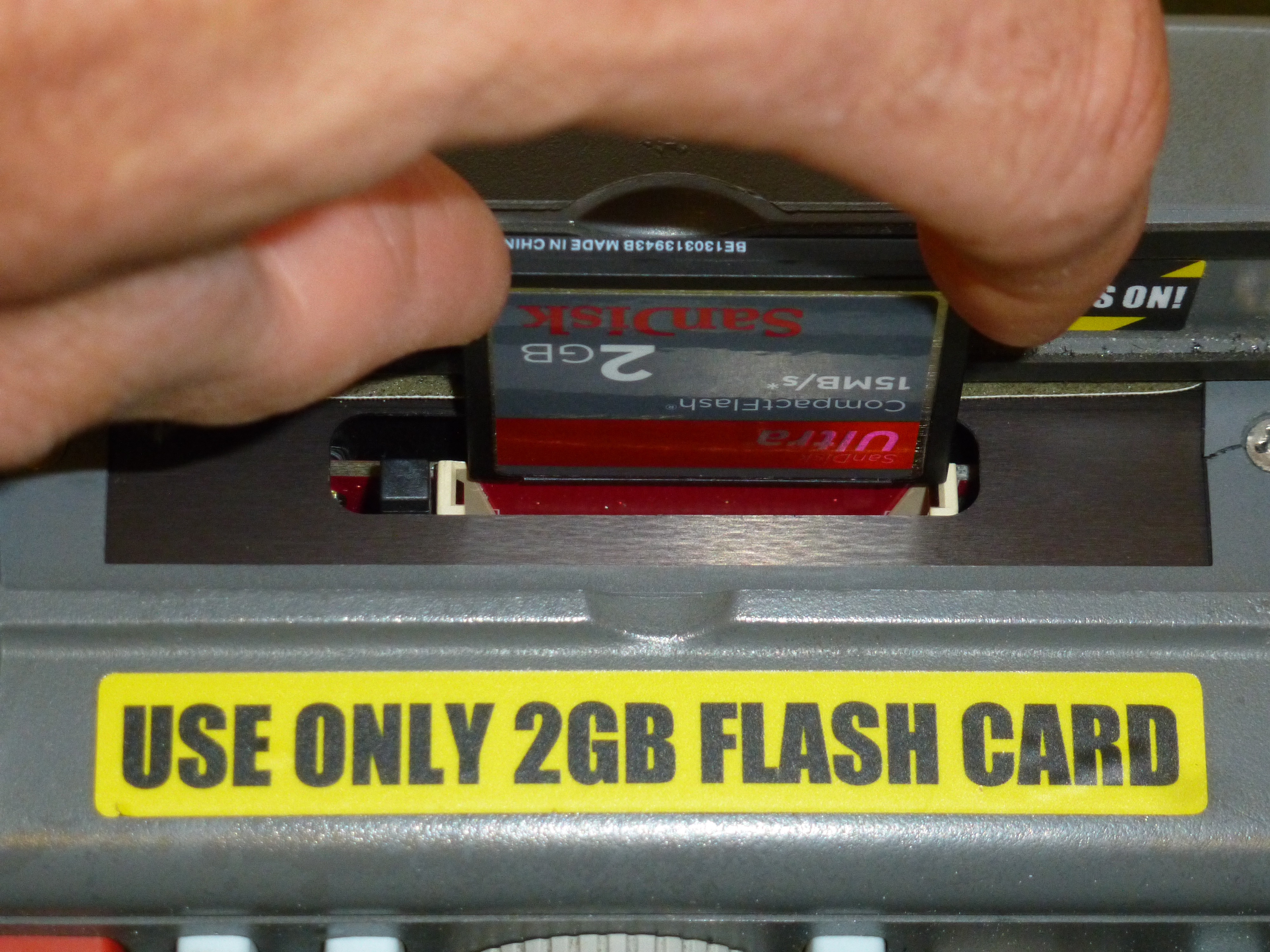 Removing the Compact Flash memory card from a recently upgraded CMA 4000  OTDR is easy.